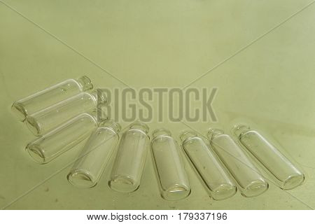 Pastel Green Background Paper With The Image Of A Glass Bottle In The Plane At The Bottom.