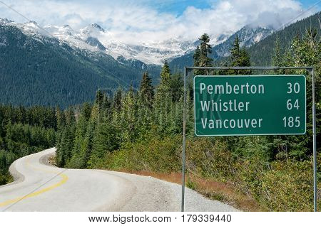 Road Sign in British Columbia:  A sign provides distances to popular destinations along a scenic road in British Columbia.