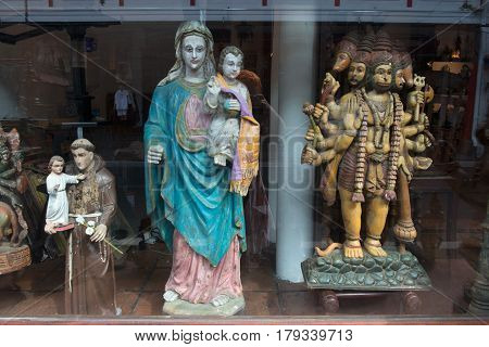 Fair sale of accessories for the decoration of churches: Catholic Christian and Hindu sculptures of the gods together Cochin Kerala South India.