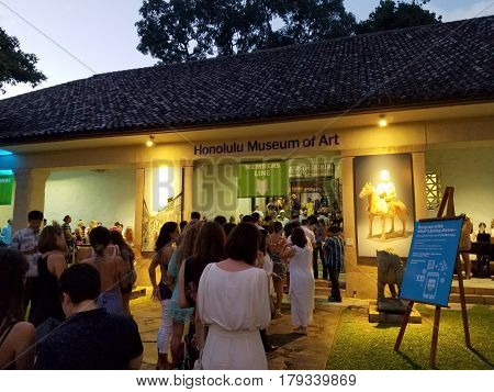 HONOLULU HAWAII JULY 29 2016: Line of people wait to get into Art After Dark event at the Honolulu Museum of Art.