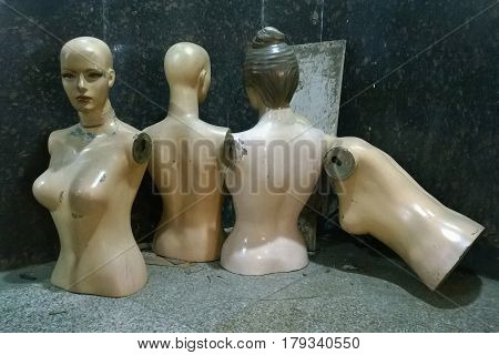 Old Broken Mannequins, Female Bodies Without Hands, Sad Facial Expression Thrown In The Street.