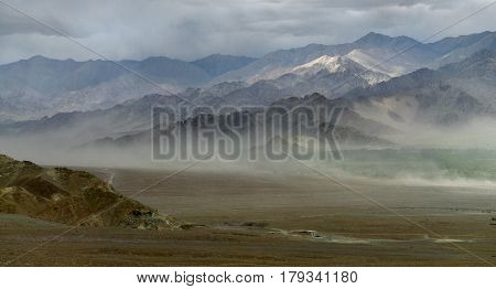 Silhouette Of The Mountain During A Dust Storm, Sand Wall Creates Haze And Travel Along The Ground,