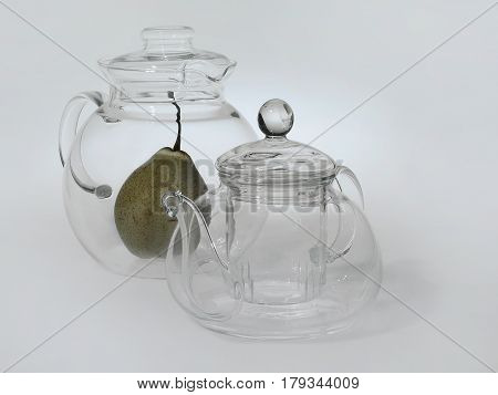 Two Glass Transparent Teapots Stand Next To Each Other, Inside A Large Round Teapot A Green Pear, Li
