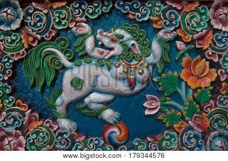 Bright Colorful Bas-relief With An Image Of The Mythical Figure Of Snow Lion, A Symbol Of Tibetan Bu