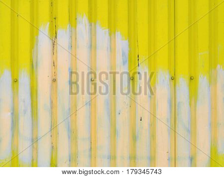 Bright Yellow With White Stain Metal Wall Background Texture With Screws In The Middle And Space For