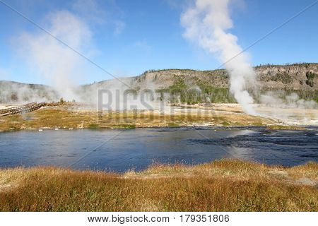 Biscuit Basin In Yellowstone National Park with steam rising