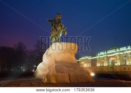 SAINT PETERSBURG, RUSSIA - MARCH 12, 2017: The monument to Peter the Great (bronze horseman) on the Senate square on a foggy March night. Saint Petersburg, Russia