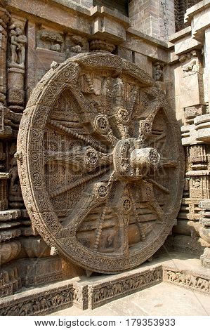 Detail of intricately carved stone wheel of chariot at Sun Temple in Konark Orissa India Asia