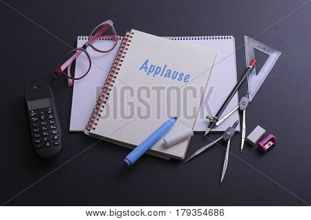 Applause Word On Notebook On Black Table.