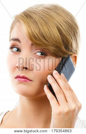 Unhappy worried sad woman talking on mobile phone and informing someone about bad news communication and negative emotion concept