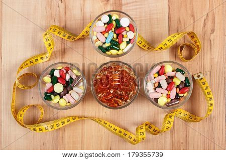 Colorful Medical Pills And Capsules With Centimeter, Health Care And Slimming Concept