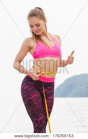 Slim Girl In Sporty Clothes With Centimeter On Beach, Sports Lifestyle, Slimming Concept