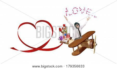 A man in love a pilot flies on a toy wooden plane to congratulate your favorite on the holiday