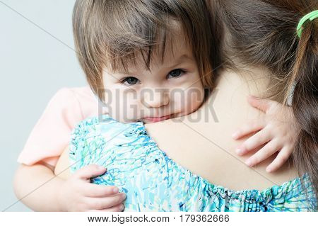 Mother hugging child physical contact family relationships cuddling baby for physical affection communicate happy daughterhappy childhood for little girl mother holding child lovely maternity poster