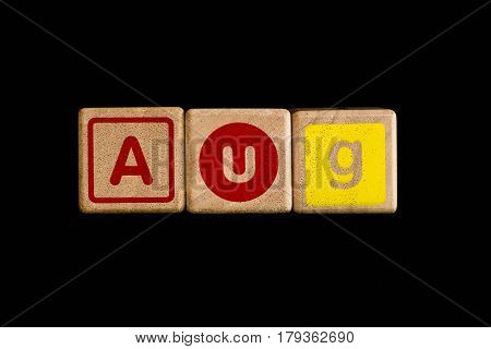 August on wood Cubic on black background