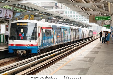 BANGKOK THAILAND - DECEMBER 10 2016: BTS Skytrain going to station. The Bangkok Mass Transit System commonly known as the BTS or the Skytrain consists more 34 stations.