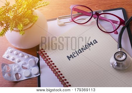 Stethoscope On Note Book With Melanoma Words As Medical Concept.