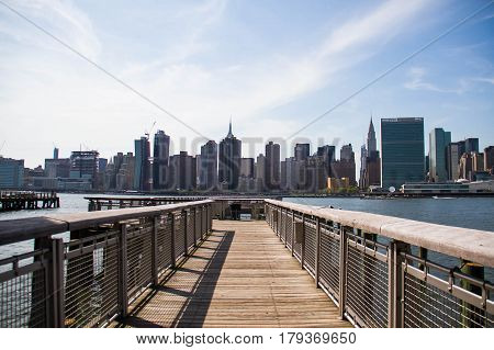 Pier at Gantry Plaza State Park and Manhattan city, New York