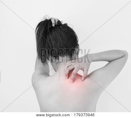 Women scratching the itch on shoulder Healthcare and medicine concept.