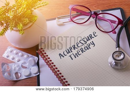 Stethoscope On Note Book With Acupressure Therapy Words As Medical Concept.
