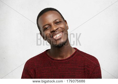 Positive Human Facial Expressions And Emotions. Headshot Of Handsome Happy Dark-skinned Man Dressed