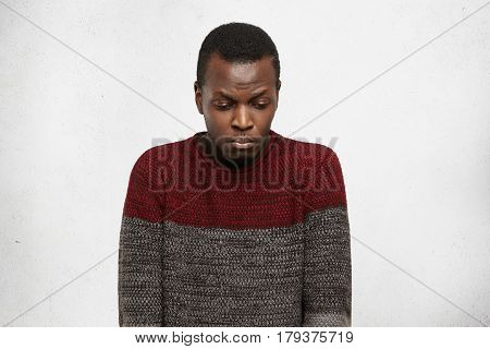 Unhappy Afro American Student Feeling Uncomfortable And Ashamed, Looking Down With Sad Expression Wh
