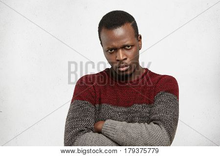 Close Up Studio Shot Of Confident Young Afro American Man Keeping Arms Crossed Looking At Camera Wit