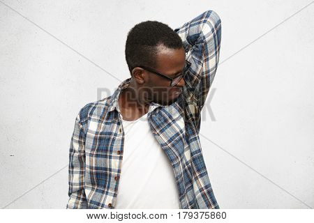 Disgusted Young Male Wearing Checkered Shirt And Glasses Smelling Wet Sweaty Armpit After Stressful