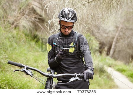 People, Active Lifestyle, Sports And Technology Concept. Serious Male Rider Wearing Protective Gear