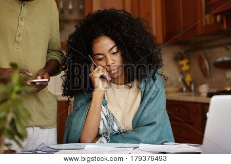 Stressed Worried Dark-skinned Female With Afro Hairstyle Having Phone Conversation With Friend Askin