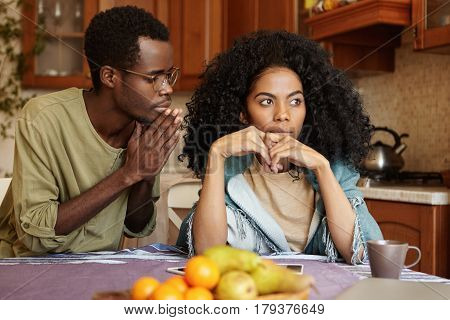 Afro-american Couple Going Through Hard Times In Their Relationships. Guilty Unfaithful Young Man Ke