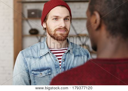 I'm Happy For You. Indoor Shot Of Handsome Fashionable Young Caucasian Man Talking To His African Am