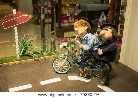 Little dolls of policemen on a bicycle in a children's theater of dolls