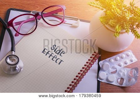 Stethoscope On Note Book With Side Effect Words As Medical Concept.