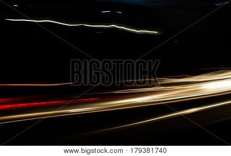 Car lights trace in the street at nigth