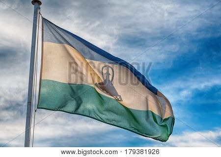 In The Cloudy Sky Waving Flag