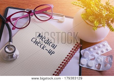 Stethoscope On Note Book With Medical Checkup Words As Medical Concept.
