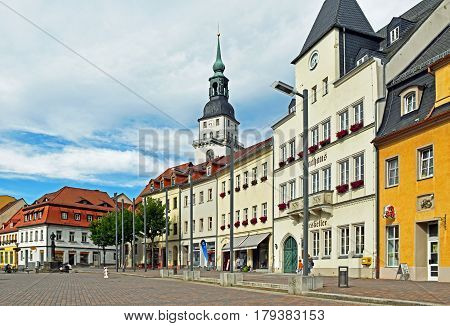 Frankenberg, Germany - June 15, 2016: People sitting around a fountain on the Market Square of Frankenberg in Saxony (Germany).
