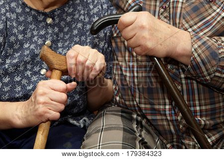 Old Couple Hands With Cane