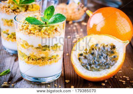 Yoghurt Granola Parfait With Passion Fruit Sauce And Mint