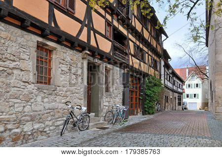 Old narrow street with half-timbered houses and bicycles. Tubingen, Baden-Wuerttemberg, Germany.