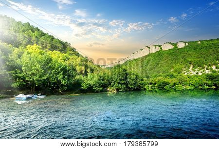Tranquil backwater in mountains in sunny morning