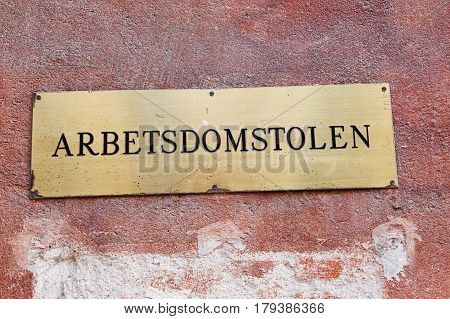 Stockholm Sweden - August 4 2014: Sign at the entrance to the Swedish Labour Court (Arbetsdomstolen) is a special court set up to hear and rule on labour related disputes. The court is located at street Stora Nygatan.
