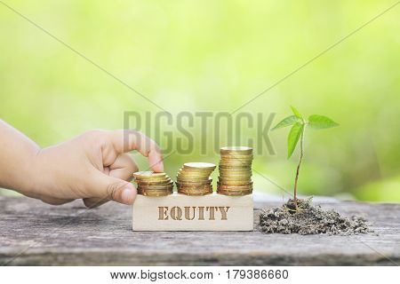 Equity Word Golden Coin Stacked With Wooden Bar.