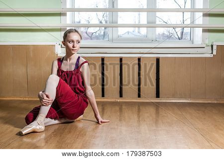 young girl in ballet class practicing her movements and jests