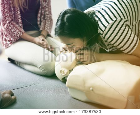 Group of people CPR first aid training course