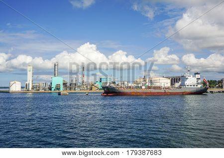 Labuan,Malaysia-Mac 25,2017:Cargo vessel loading in Petrochemical industry in the Petronas Methanol at Rancha Rancha Industrial,Labuan,Malaysia.Petronas Methanol Labuan engages in the production of methanol Malaysian oil & gas.