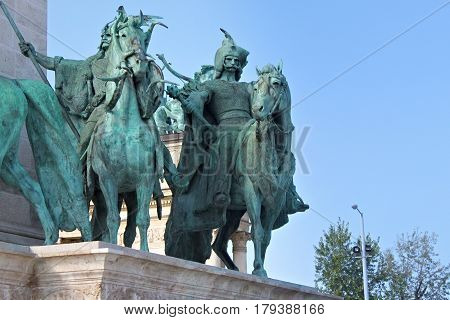 BUDAPEST, HUNGARY - AUGUST 08, 2012: Millennium Monument on the Heroes' Square. Side view of several of the seven statues of the Seven chieftains of the Magyars.