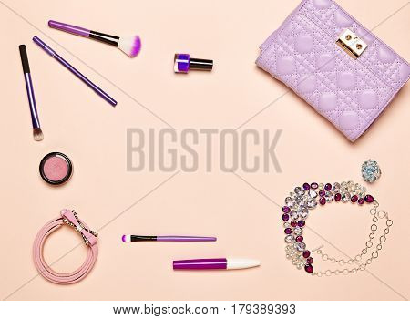 Fashion lady accessories set. Falt Lay. Stylish handbag. Make-Up brushes. Jewelry and nail polish. Women accessories