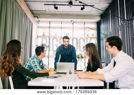 Business People Having Board Meeting In Modern Office. Teamwork